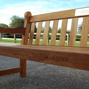Harrow School bench with engraving and plaque
